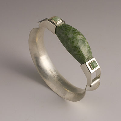 green jadeite and sterling silver bangle
