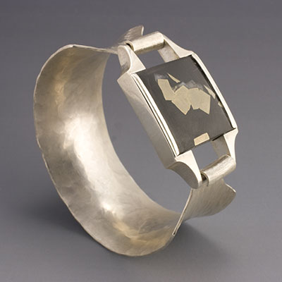 hammer formed & cast silver bangle with pyrite included slate cabochon